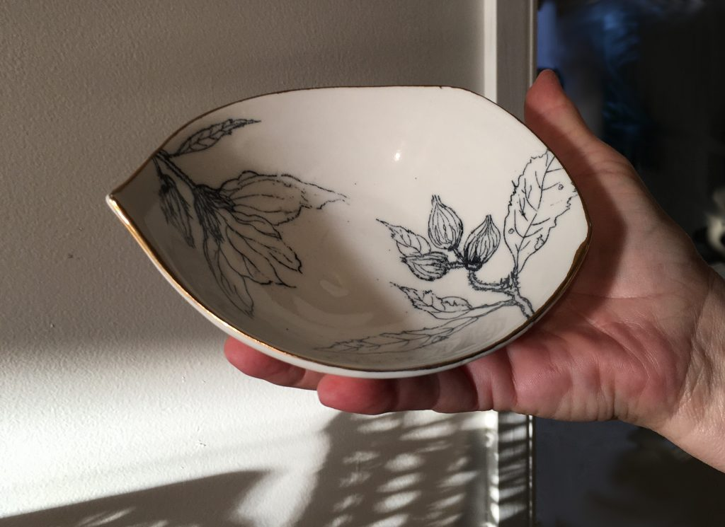 Porcelain with hand drawn decal and gold lustre edge by Simon Suckling