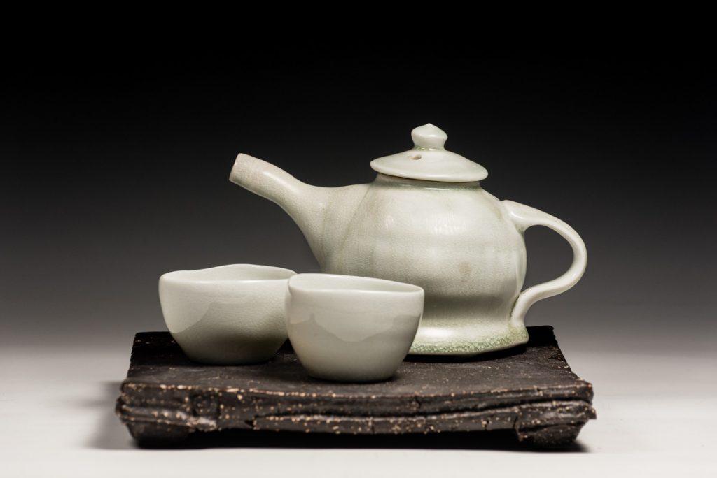 porcelain teapot black stoneware base