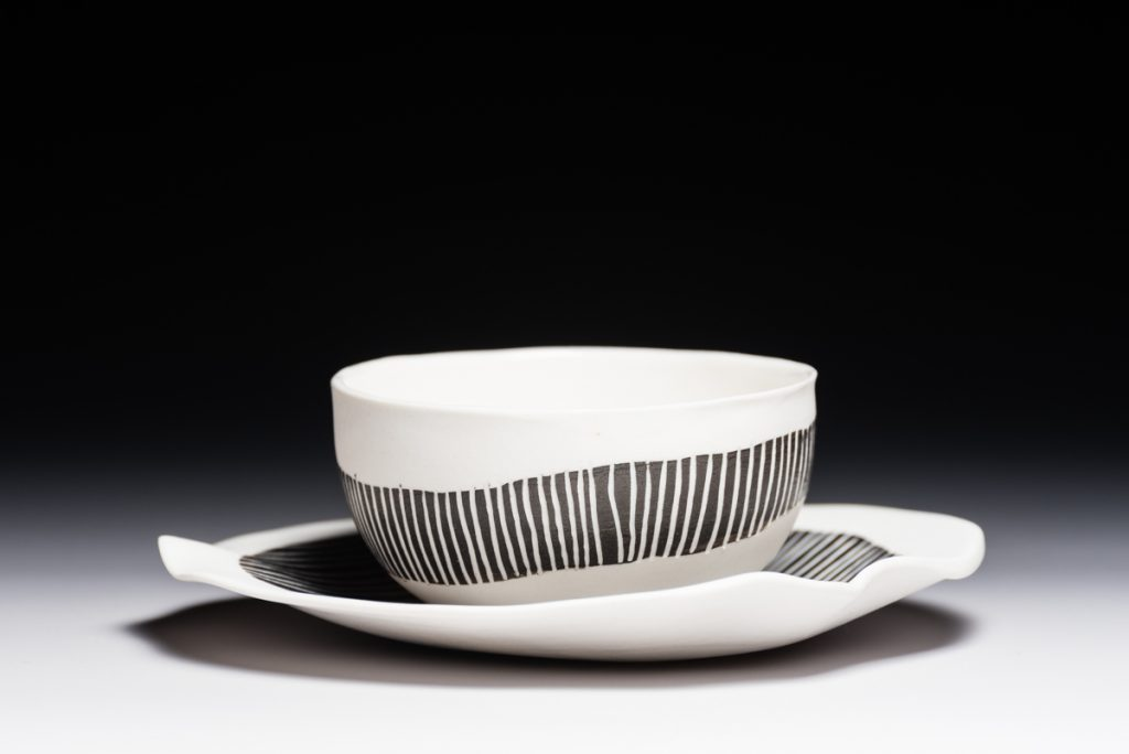 Saucers with black and white slip and sgraffito decoration